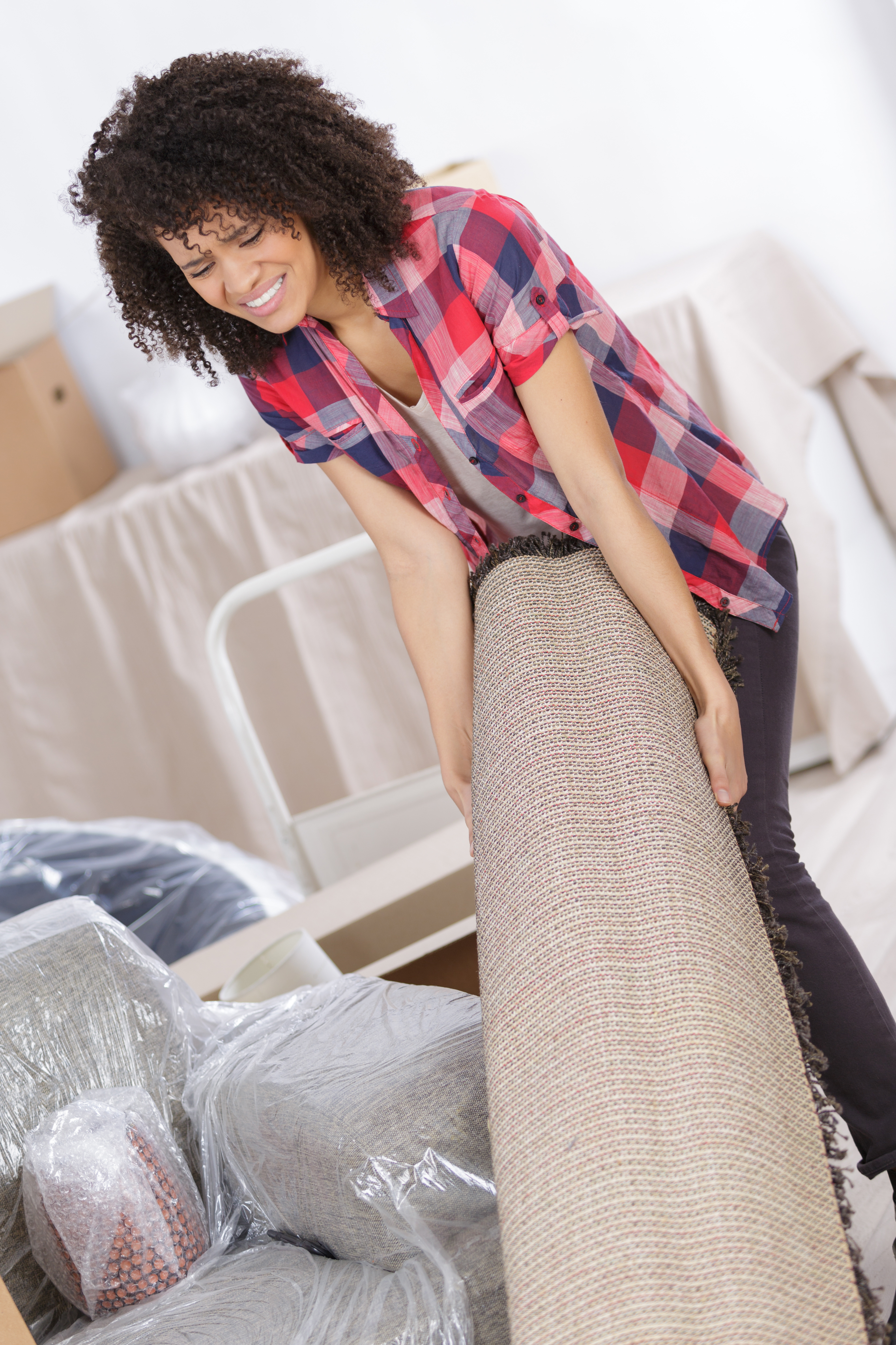 Woman Suffering From Backache While Moving Carpet Bock S